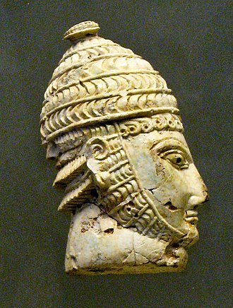 Acropolis of Athens - Warrior wearing a boar tusk helmet, from a Mycenaean chamber tomb in the Acropolis of Athens, 14th-13th century BC.