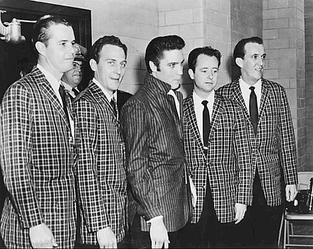Presley with his longtime vocal backup group, the Jordanaires, March 1957 Elvis Presley and the Jordanaires 1957.jpg