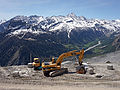 Excavator and mountains.jpg