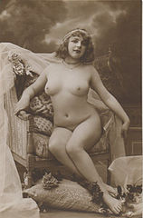 Fernande in easy chair from French postcard.jpg