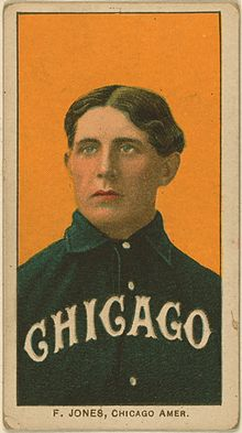 "Baseball card showing medium shot of white man with brown hair parted in the center wearing a baseball shirt with ""Chicago"" written across it"