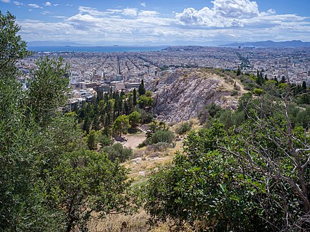View of Athens and the Saronic Gulf from the Philopappou Hill. Filopappou Hill or Hill of the Muses in Athens.jpg