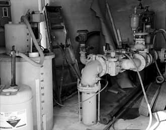 Water fluoridation - Fluoride monitor (at left) in a community water tower pumphouse, Minnesota, 1987