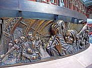Frieze round The Meeting Place sculpture, St Pancras - geograph.org.uk - 1618205.jpg
