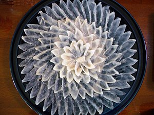 Sashimi - Plate of fugu sashimi (thinly sliced Puffer fish)