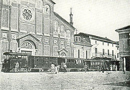 Gambolò, steam tramway and church.JPG