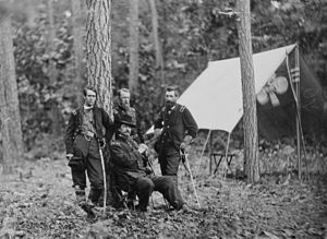 Francis C. Barlow - Maj. Gen. Winfield S. Hancock and generals during the Overland Campaign. Standing, from left to right, are Barlow (wearing his familiar checked shirt), David B. Birney, and John Gibbon.