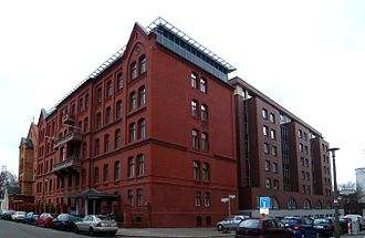 Berlin Missionary Society - The Mission House (in bright brick; 1873) with its extension (in darker brick; end of the 19th century) and the new extension (clinker; 1996) form now Evangelisches Zentrum (Evangelical Centre), the head offices of EKBO.