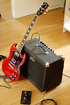 Gibson SG with amp.jpg