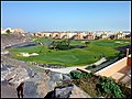 Golf course in the middle of buildings - panoramio.jpg