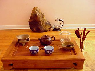 Gongfu tea ceremony - A gongfu tea table with accessories
