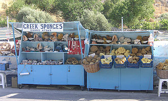 Market stall - Sponges are sold at this roadside stall near Akti Bay on the island of Kalymnos, Greece.