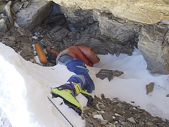 David Sharp (mountaineer) - Photo of Green Boots, the unidentified corpse of a climber that became a landmark on the main Northeast ridge route of Mount Everest
