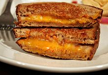A cross-cut of a grilled cheese sandwich