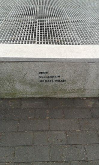 "Guggenheim Helsinki Plan - Anti-Guggenheim graffiti campaign, late 2014. The slogan reads ""Fuck Guggenheim – We Have Walls""."