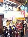HK Mongkok night Nathan Road KMBus 117 104 stop sign Dec-2012.JPG