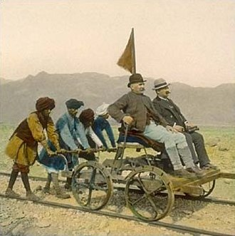Handcar - A magic lantern image from circa 1895, shows four natives from British India pushing a hand-car in Bolan Pass (now in Pakistan).
