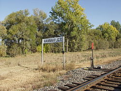 Sign for Hannah Junction along the railroad