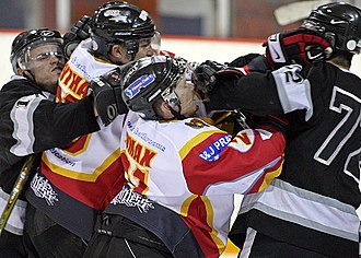 Blackburn Hawks - Players from the Blackburn Hawks and Flintshire Freeze ice hockey teams fight during an English National Ice Hockey League game