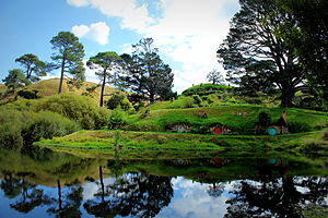 Hobbiton Movie Set - Hobbit holes overlooking the lake on the set