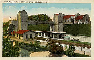 Lake Hopatcong station - A 1911 postcard view of the brand-new station. The Morris Canal runs along the southern edge of the Scranton-bound platform.