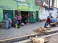 Huancayo Peru- sheep skin buyer-seller.jpg