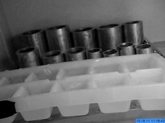 File:Ice spike growing in ice cube tray in refrigerator.ogv