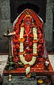 Image of Lord Ganesh with three trunks and six hands and seated on a peacock - Trishundya Mayureshwar Ganapati temple, Pune.jpg