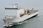 Image of RFA Lyme Bay, seen here with a Lynx Wildcat helicopter landing on the flight deck. MOD 45159805.jpg