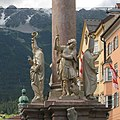 Innsbruck Annasäule detail (from left) Ss. Cassian of Imola, George, Vigilius of Trent - viewn from c.South.jpg