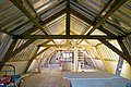 Interieur kaaspakhuis, op tweede verdieping een overzicht van de kapconstructie, spanten met dakgebint, tijdens werkzaamheden - Bodegraven - 20412758 - RCE.jpg