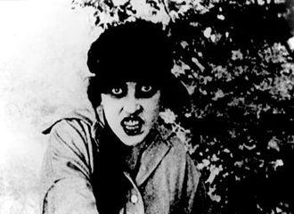 """Les Vampires - Irma Vep (Musidora) singing in the """"Howling Cat"""" nightclub in """"The Red Codebook""""."""
