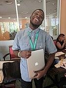 Jaime Tubers with a hardware donation program laptop.jpg