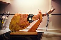 A jamón leg in a cutting stand.