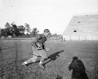 1905 Northwestern Purple football team - Johnson practicing before the game.