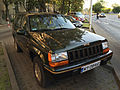 Jeep Grand Cherokee Limited (ZJ) green European Specs in Warsaw Poland front.jpg