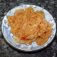 pile of slimy strips of uncooked orange fish flesh.