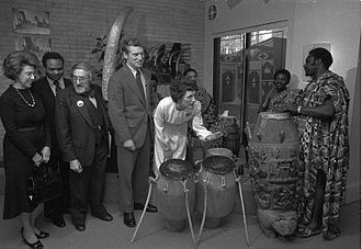 Joan Mondale - Mondale playing the drums after a press conference at the National Museum of African Art with, (l-r), Rep. Lindy Boggs, Rep. Walter E. Fauntroy, Warren M. Robbins (founder of the Museum), and Sen. Wendell Anderson, 1978.