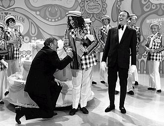 Tiny Tim (musician) - John Wayne and Tiny Tim help celebrate the 100th episode of Laugh-In, 1971