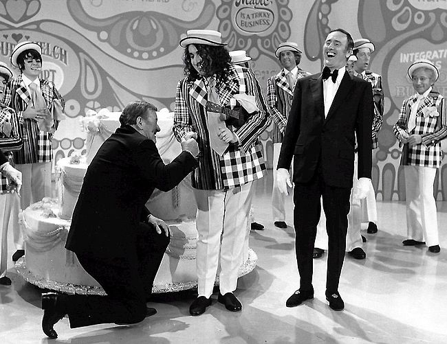 John Wayne and Tiny Tim help celebrate the 100th episode in 1971 - Rowan & Martin's Laugh-In