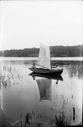 Nagu - Sailboat on the water at Nagu. The Maritime House presents the naval history of the islands.
