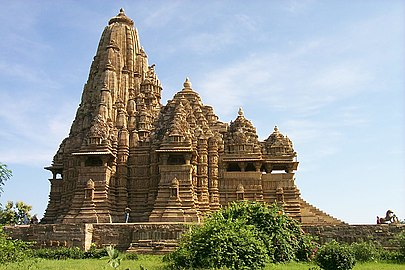 Kandariya Mahadeva Temple in the Khajuraho complex was built by the Chandelas, who were feudatories of the Gurjara-Pratiharas. The complex is the greatest development of Gurjara-Pratihara style of temple building and famous for nagara-style architectural symbolism and erotic sculptures.[252]