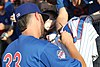 Kris Bryant signing autographs during his rehab assignment against Omaha (29379054837).jpg