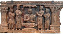 Coppia di Kushan devoto, nei dintorni di Buddha, Brahma e Indra.