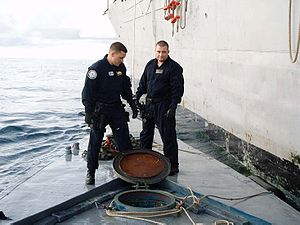 Law Enforcement Detachments - Members of LEDET 404 survey the deck of the self-propelled, semi-submersible craft they seized on September 13, 2008.