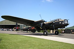 Lincolnshire Aviation Heritage Centre - Lancaster NX611 in front of the museum's buildings (2007)