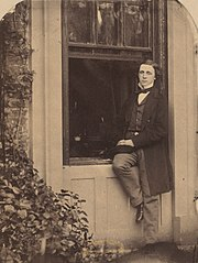 Lewis Carroll Seated on a Windowsill of the Old Rectory at Croft, Darlington, Yorkshire