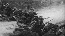 Infanterisoldater som deltar i forsvaret av Liège i forstedene til Herstal.