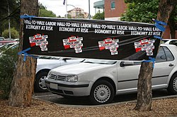 "Liberal Party banners displayed at polling booths on election day featuring slogans ""WALL-TO-WALL LABOR"" and ""ECONOMY AT RISK"" to discourage people from voting Labor. With all Australian states and territories governed by Labor since 2002, a federal Labor victory became the first time the party concurrently held all federal, state and territory governments."