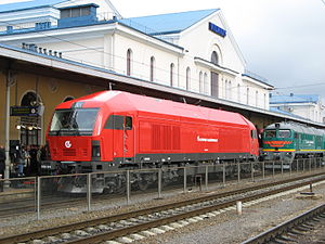 Lithuanian Railways - Siemens ER20 CF locomotive (red) and 2M62U locomotive (green) at the central station in Vilnius